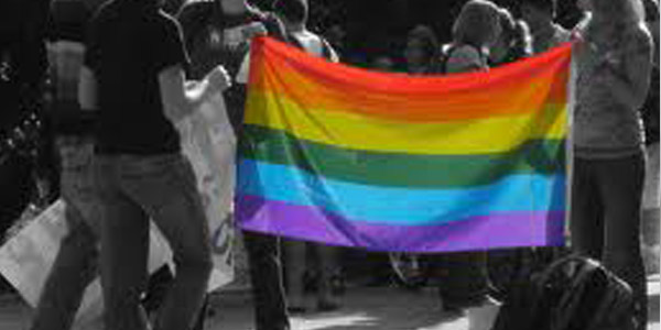rainbow flag and students 600x300